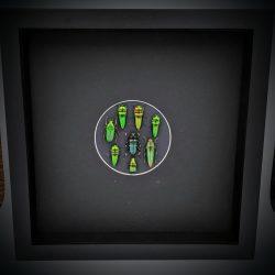 kader met groene kevers